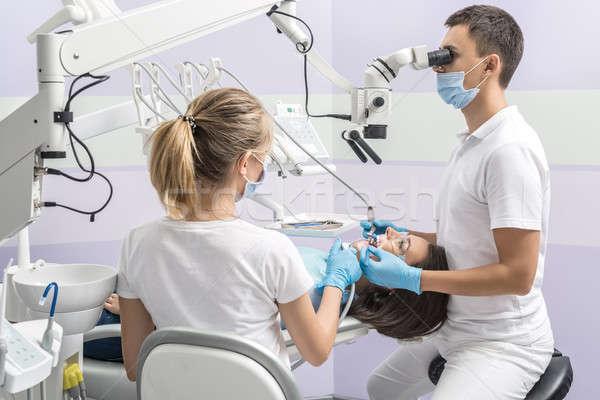 Treatment at dentist's office Stock photo © bezikus