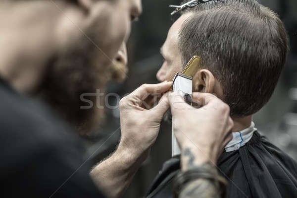 Doing haircut in barbershop Stock photo © bezikus