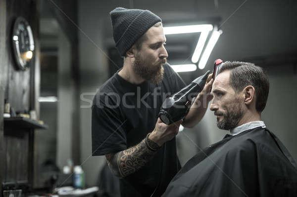 Drying hair in barbershop Stock photo © bezikus