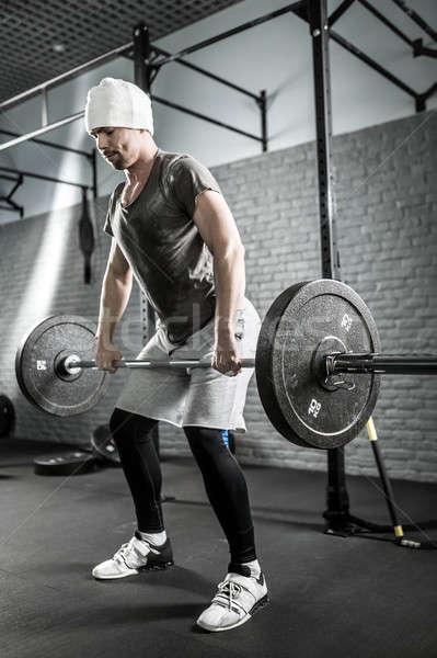 Crossfit edzés súlyzó brutális férfi szakáll Stock fotó © bezikus