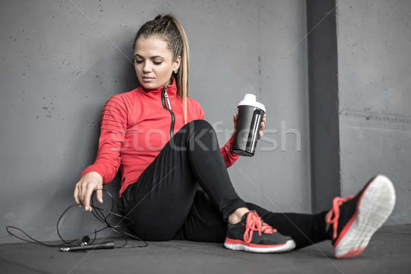 Sportive girl relaxing in gym Stock photo © bezikus