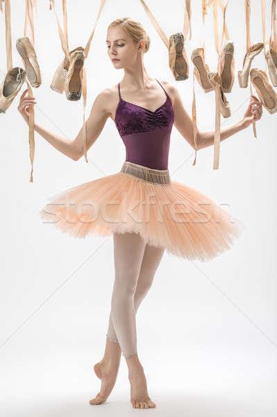 Blonde ballerina and pointe shoes Stock photo © bezikus