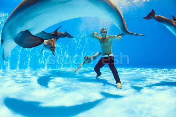 ボトム 二人の男性 3  イルカ 周りに 水 ストックフォト © bezikus