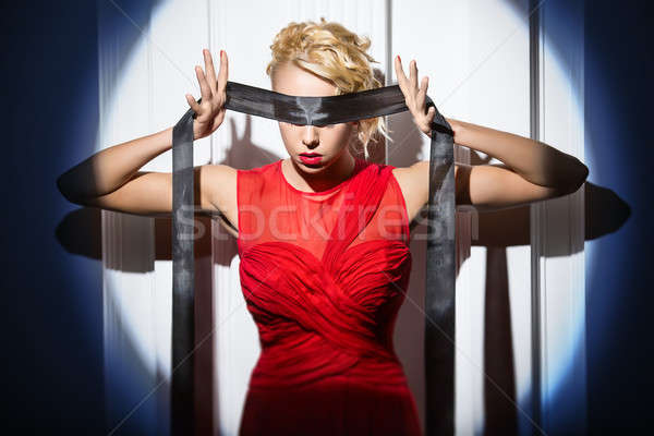 Gymnast in the bright red dress is standing with a black ribbon  Stock photo © bezikus