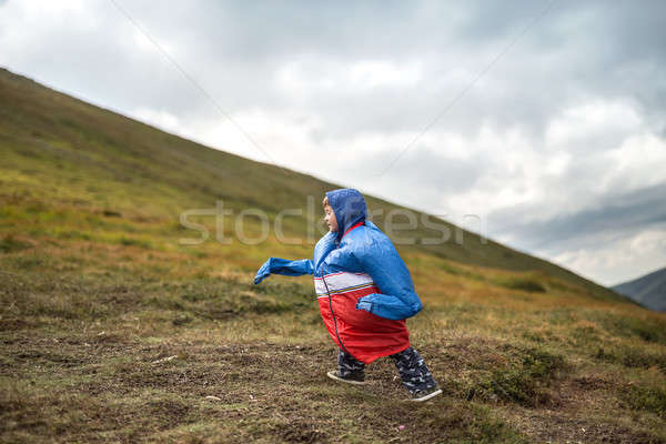 Stock photo: Boy walks on mountain