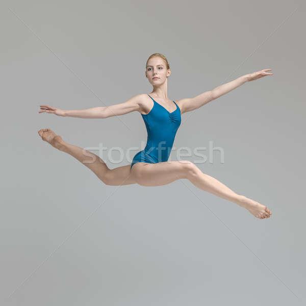 Ballerina posing in jump Stock photo © bezikus