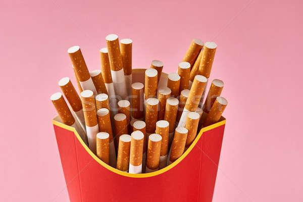 Many cigarettes in red carton Stock photo © bezikus