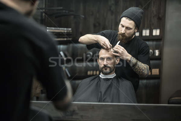 Preparing for haircut in barbershop Stock photo © bezikus