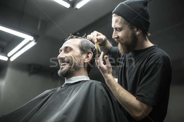 Cutting hair in barbershop Stock photo © bezikus