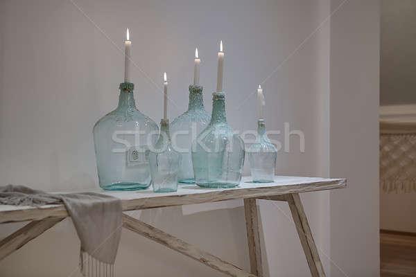 Design verre brûlant bougies élégant bouteilles Photo stock © bezikus