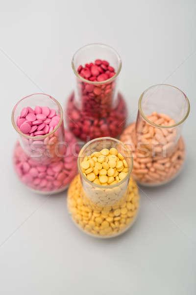 üveg tabletták négy sok színes placebo Stock fotó © bezikus