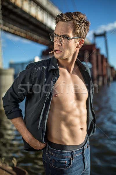 Sigara tiryakisi iskele sevimli adam gözlük karanlık Stok fotoğraf © bezikus