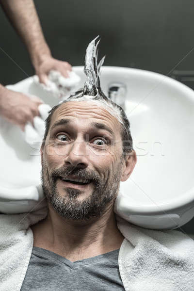 Elegante hombre funny barba mentiras blanco Foto stock © bezikus
