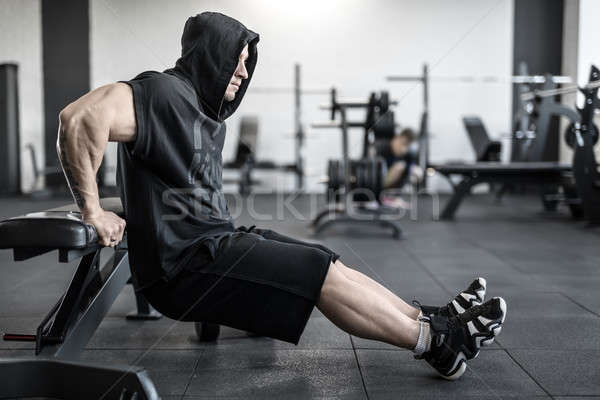 Brutal man in gym Stock photo © bezikus
