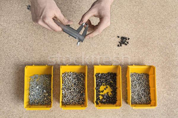 Plastic dozen mannelijke handen vier Geel Stockfoto © bezikus