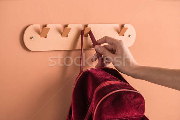 Metal orange hanger with red backpack Stock photo © bezikus