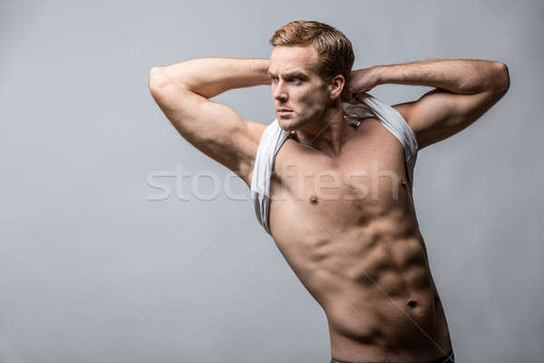 Muscular man in studio  Stock photo © bezikus