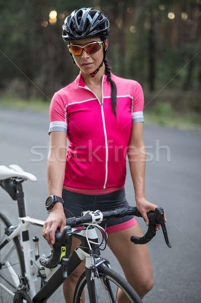 Kadın bisikletçi açık havada kız bisiklet yol Stok fotoğraf © bezikus