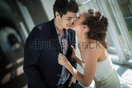Newlywed couple near a window Stock photo © bezikus