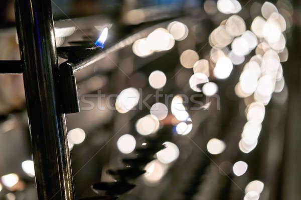 Oil candles inside buddhist temple Stock photo © bezikus
