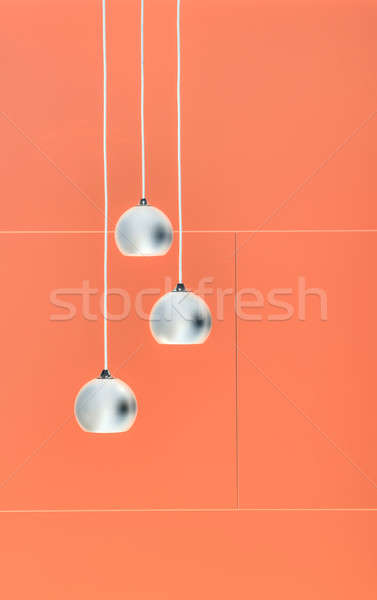 Arancione negative collage tre soffitto luci Foto d'archivio © bezikus