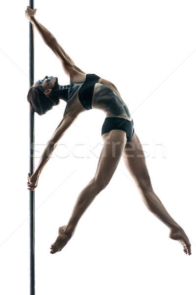 Female pole dancer with body-art on pylon Stock photo © bezikus