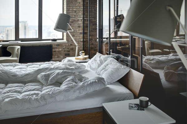 Hálószoba padlás stílus téglafal ágy párnák Stock fotó © bezikus