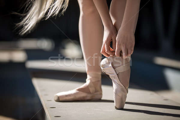 Stock photo: Dancer tying pointe shoes