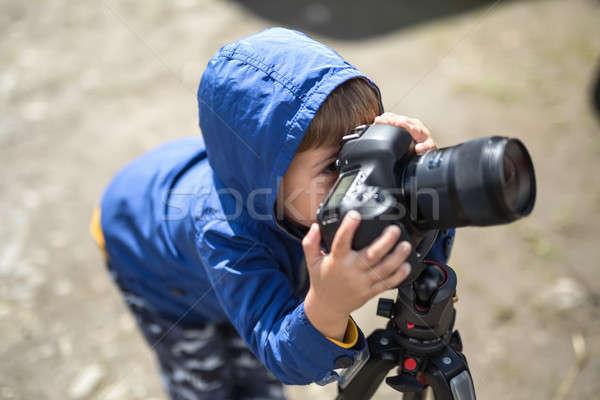 Kid with photo camera Stock photo © bezikus