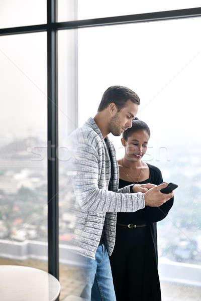 Casal alegre posando grande windows olhando Foto stock © bezikus