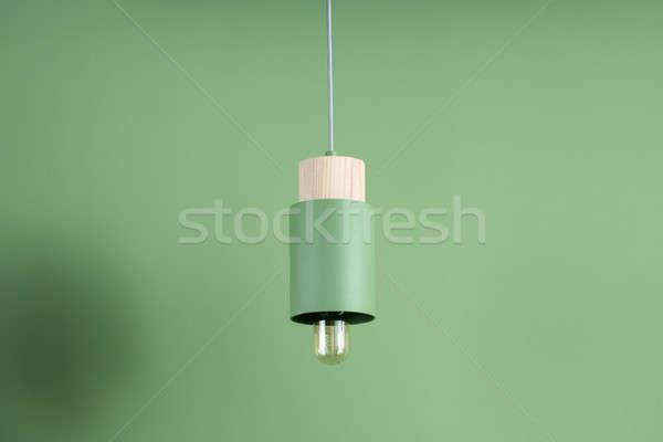 Hanging metal green edison lamp with wooden part Stock photo © bezikus