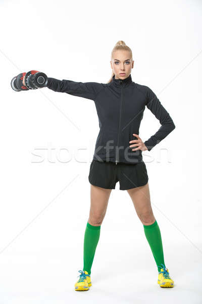 Stock photo: Athletic girl with dumbbell