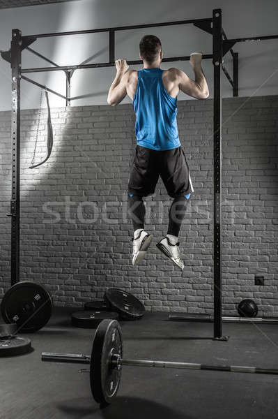 Young man makes pull-up workout Stock photo © bezikus