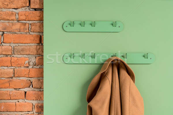 Metal green hangers with jacket Stock photo © bezikus