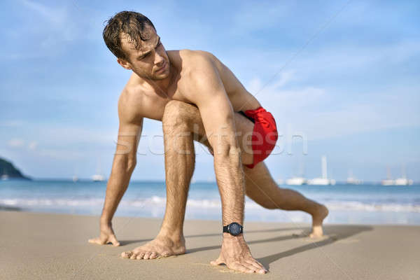 Tanned guy on beach Stock photo © bezikus