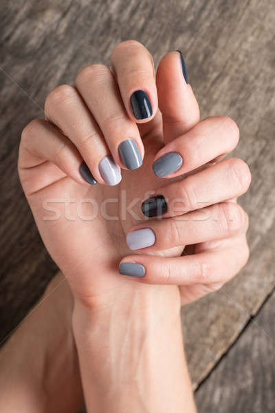 Beautiful hands with the miniature painted in a gray-colored nai Stock photo © bezikus