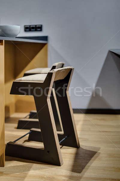 Kettő fából készült pár asztal szürke fal Stock fotó © bezikus