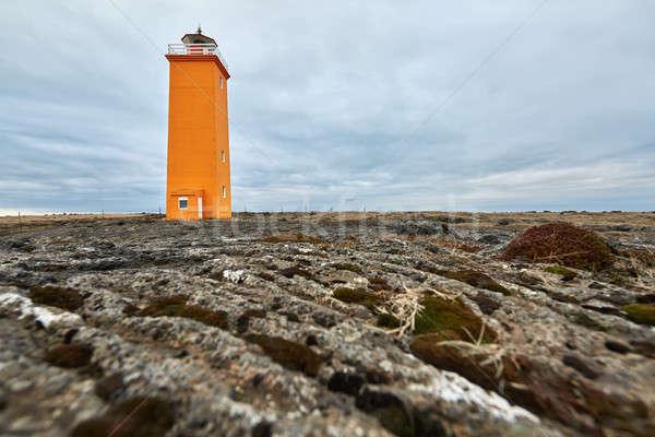 Icelandic landscape with orange lighthouse Stock photo © bezikus
