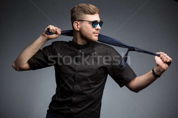 Stylish man in black shirt and mirrored sunglasses Stock photo © bezikus