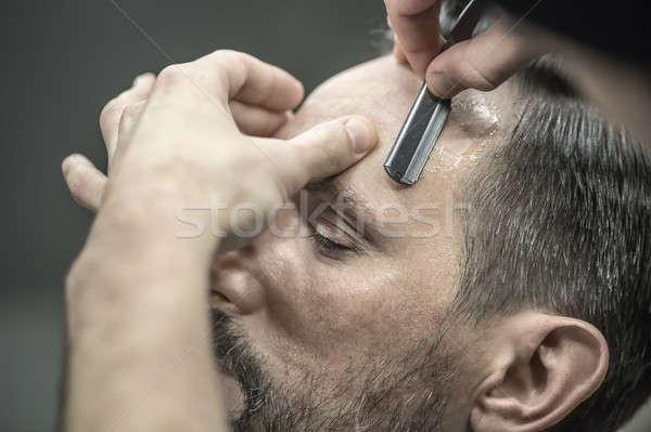 Trimming hair in barbershop Stock photo © bezikus
