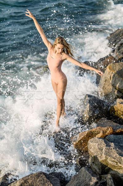 Ballerina posing on seashore Stock photo © bezikus