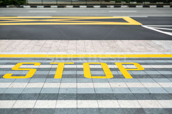 Yellow road marking on road Stock photo © bezikus
