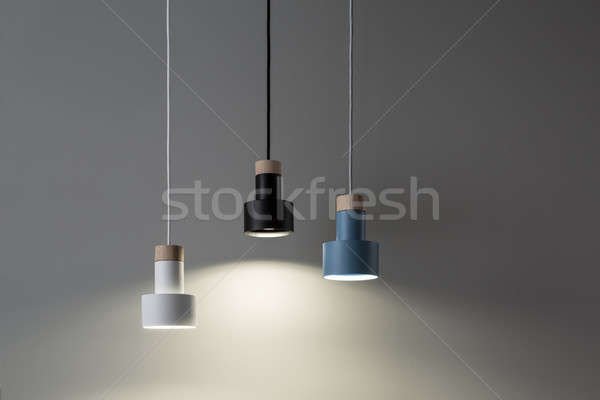 Hanging luminous colorful lamps Stock photo © bezikus