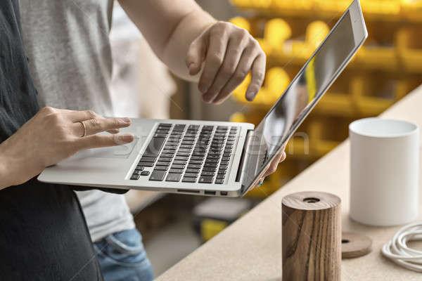 Couple using laptop in workshop  Stock photo © bezikus