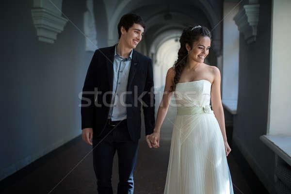 счастливым пару вниз долго коридор , держась за руки Сток-фото © bezikus