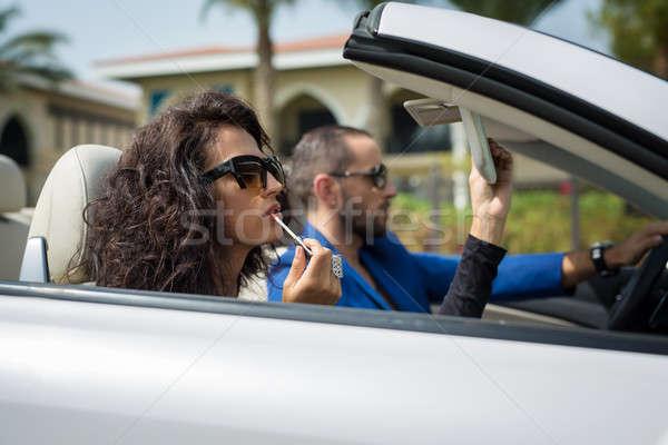 Coppia auto ragazza vestito nero uomo blu Foto d'archivio © bezikus