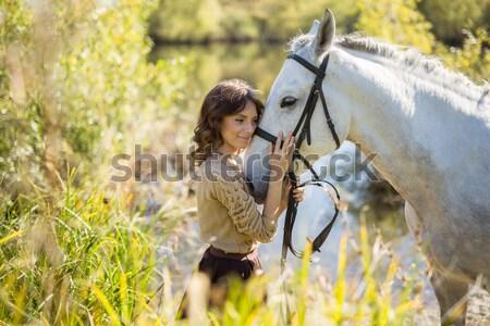 Gyönyörű lány fehér ló gyönyörű barna hajú buja szoknya Stock fotó © bezikus