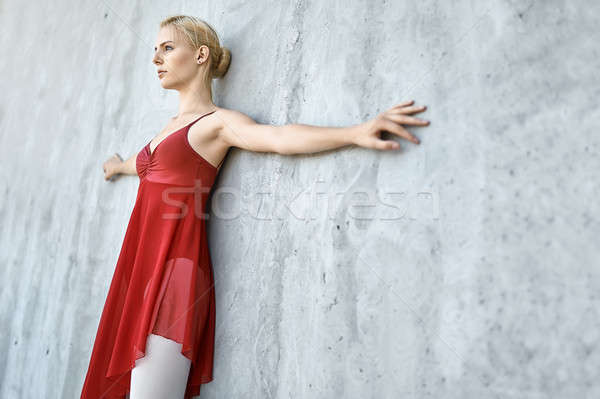 Ballerina on concrete wall background Stock photo © bezikus