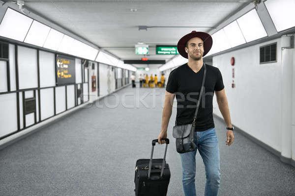 Young guy in airport Stock photo © bezikus