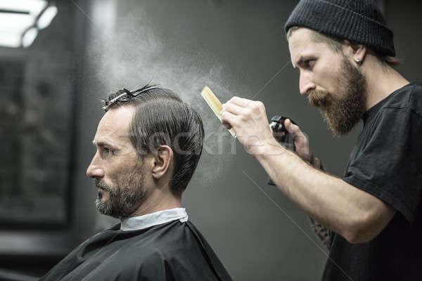 Barbero aerosol botella elegante grande barba Foto stock © bezikus